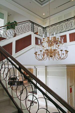 Elegant chandelier and staircase luxurious interior design photo