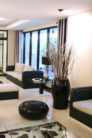 interior lighting: Living room waiting room with elegant modern black and white design Stock Photo