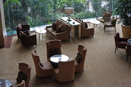 space area: Elegant cafe lounge waiting area with tables and sofas