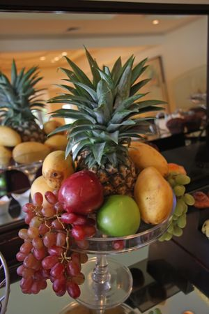 centred: Fruit basket of assorted fruits centred around pinapple Stock Photo