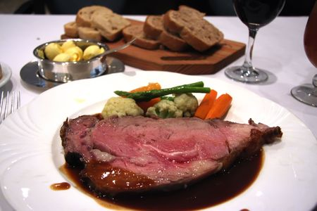 garnishing: Roast beef with garnishing on white plate