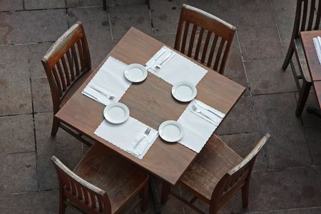 topdown: Overhead view of casual dining restaurant with wooden table and chairs Stock Photo