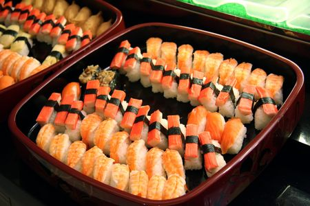 Arrangement of sushi and sashimi in a restaurant setting photo