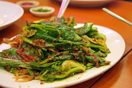 green leafy vegetables: Plate of fried green leafy vegetables Asian cuisine