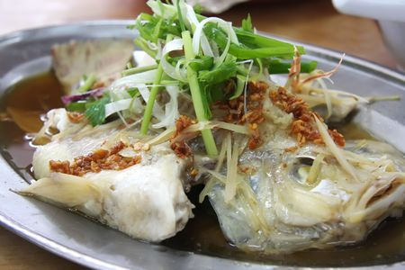steamed: Whole steamed fish with soy sauce traditional chinese cuisine Stock Photo
