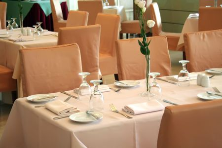 Dining table in an elegant restaurant with place setting photo