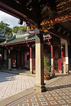 Inner courtyard of traditional chinese temple with pillars and tiles photo