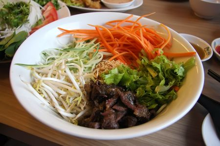 Vietnamese cuisine dish of mixed noodles beef and vegetables photo