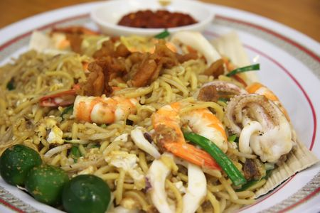 Chinese fried seafood noodles with prawns and squid Stock Photo - 2337911