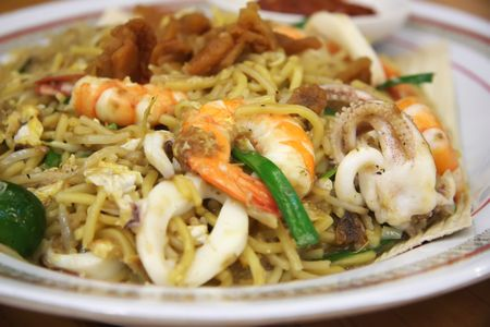 Chinese fried seafood noodles with prawns and squid photo