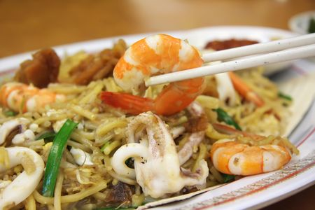 Chinese fried seafood noodles with prawns and squid Stock Photo - 2337899