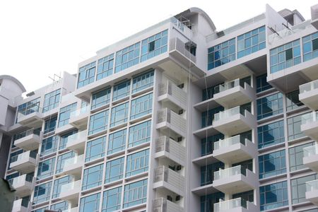 Modern apartment buildings closeup of glass balconies photo