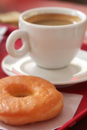 iced coffee: Donut and coffee mug on a fast food tray