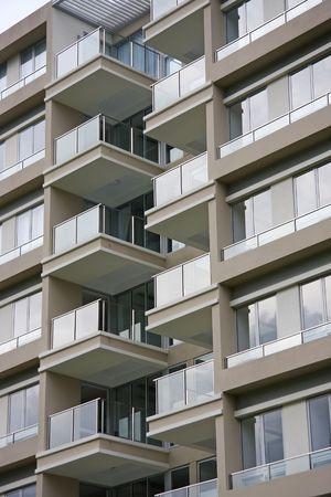 Modern apartment buildings closeup of glass balconies photo