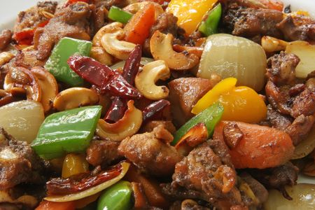 Paprika chicken with peppers and cashew nuts traditional chinese cuisine photo
