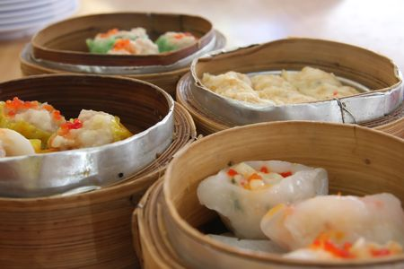 establishment: Chinese steamed dimsum in bamboo containers traditional cuisine Stock Photo