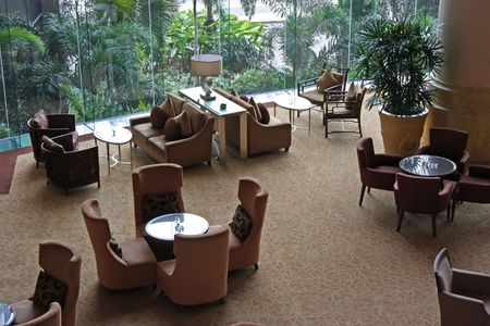 sitting area: Elegant cafe lounge waiting area with tables and sofas