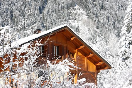 Traditional alpine cabin in the mountains of Chamonix French Alps photo