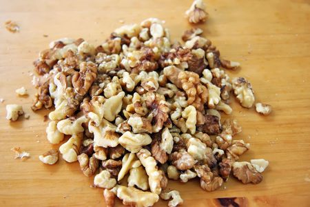shelled: Shelled walnut meat in a pile on wooden background