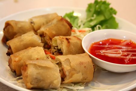 green's: Fried vietnamese spring rolls with traditional greens Stock Photo