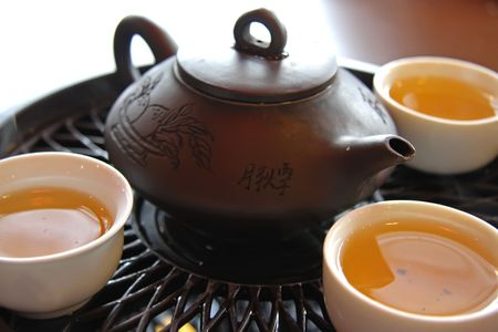 Traditional chinese tea service with ceramic pot and stand Stock Photo - 2427626