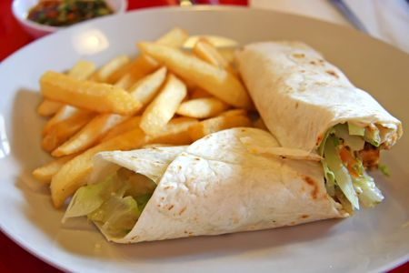 Burritos mexican cuisine wraps with french fries photo