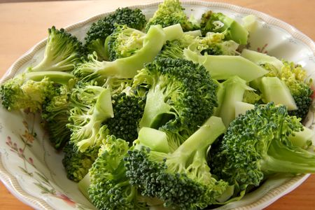 brocolli: Fresh raw sliced broccoli pieces closeup segments Stock Photo