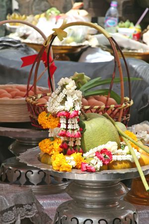 Buddhist shrine offering in Thailand with fruits and flower garlands photo
