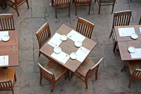 Overhead view of casual dining restaurant with wooden table and chairs photo