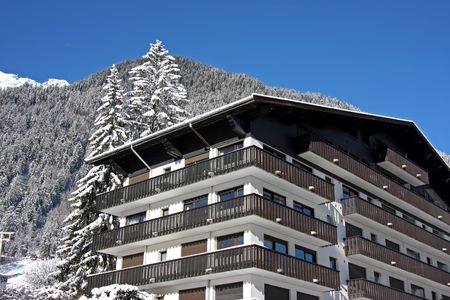 Ski resort hotel in traditional alpine cabin style Stock Photo - 2459773