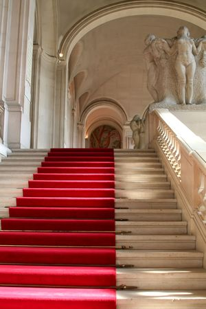 Red carpet on clasically designed marble staircase photo