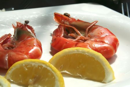 Fresh cooked prawns on white plate restaurant setting photo