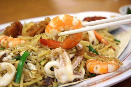 Chinese fried seafood noodles with prawns and squid Stock Photo - 2475263