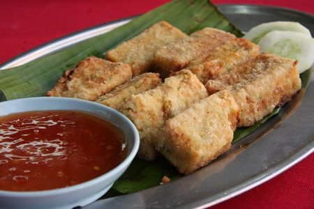 beancurd: Fried tofu beancurd with dipping sauce traditional chinese cuisine Stock Photo