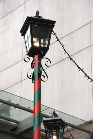 themed: Festive christmas themed lamp-post in red and green Stock Photo