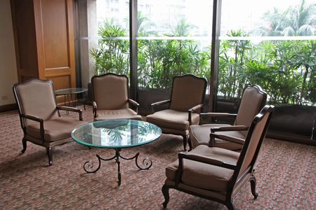 sitting area: Elegant waiting area lounge with chairs and a table