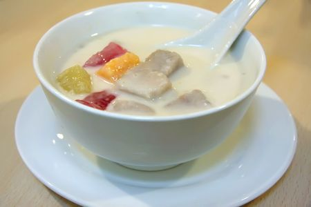 traditiional: Traditiional asian sweet dessert of coconut milk and fruits Stock Photo