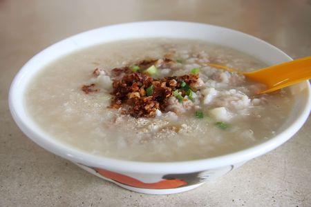 Traditional chinese porridge rice gruel in bowl photo