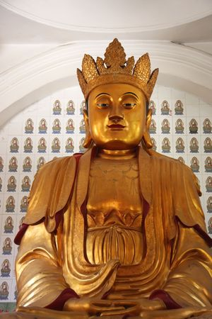 Golden statue of buddha inside a chinese temple Stock Photo - 3070821