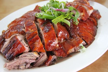 Roast duck chinese cuisine sliced portions on plate photo