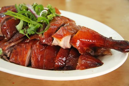 crispy: Roast duck chinese cuisine sliced portions on plate
