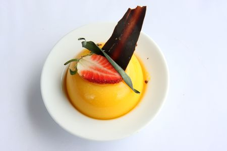 Yellow pudding fancy decorated with strawberry garnish