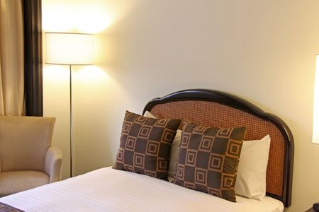 bedsheets: Bedroom of a five star business hotel with made bed