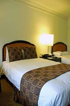 five star: Bedroom of a five star business hotel with made bed