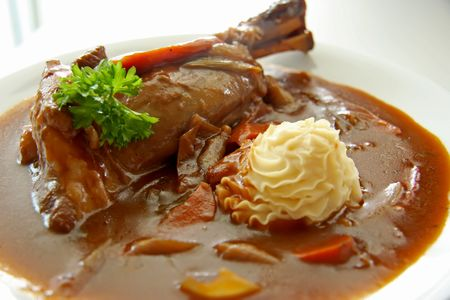 Leg of lamb stew with gravy and vegetables photo