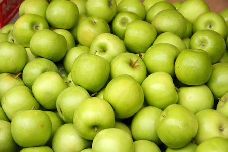 granny smith: Pile of many fresh green apples in the market Stock Photo