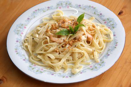 Pasta ala oglio with shrimp Italian cuisine photo