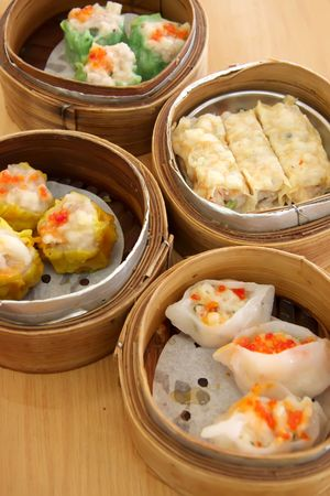 Chinese steamed dimsum in bamboo containers traditional cuisine Stock Photo - 3141853