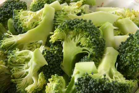 produce sections: Fresh raw sliced broccoli pieces closeup segments Stock Photo