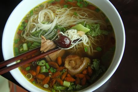 Noodles in herbal soup traditional chinese cuisine photo